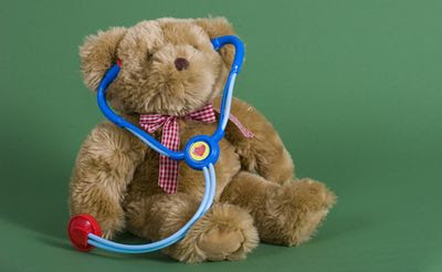 A teddy bear with a stethoscope